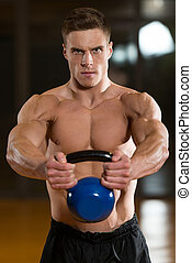 Muscular Man Exercise With KettleBell