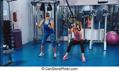 Training in the gym under the supervision of a coach