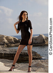 Woman in short dress on the beach - Woman in short black...