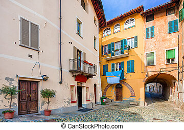 Small backstreet and colorful houses in Italy. - Small...