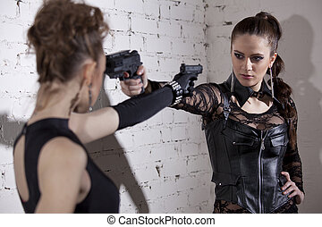 Two gangster women menacing each other
