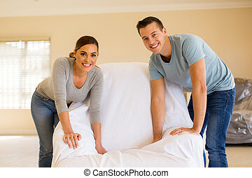 young couple redecorating their home - happy young couple...