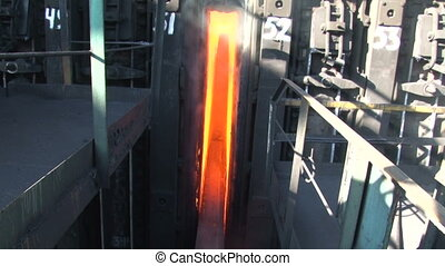 The process of ejecting hot coke from the oven - The process...