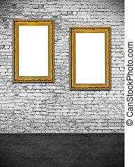Two hollow frames on white brick wall