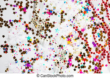 Colorful star shaped confetti on a white background