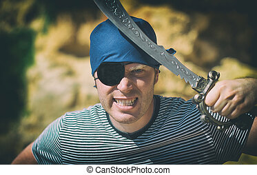Angry male pirate with sword Place for your text