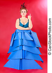 Fat Woman in Unique Blue Dress Against Red - Full Length...