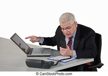 senior manager discussing on phone - a caucasian senior...