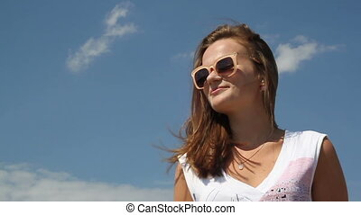 Portrait of a young woman against the sky.