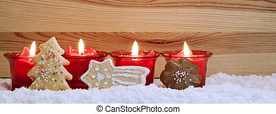 Four red candles and christmas cookies. - Christmas...