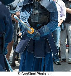 Two kendo fighters Competition with Bamboo Sword and...