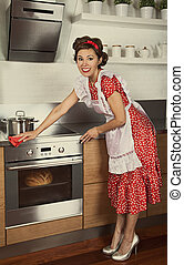 Retro housewife cleaning kitchen - Housewife doing housework...