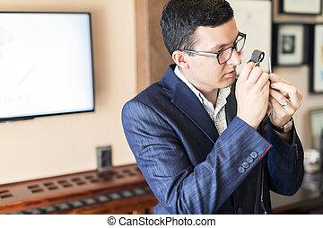 Jeweler examining diamond through loupe - Jeweler examining...