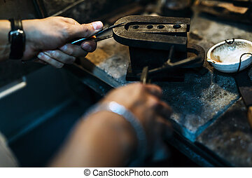Goldsmith crafting jewels the traditional way