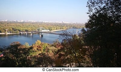 A beautiful autumn view of the pedestrian bridge over the river Dnipro