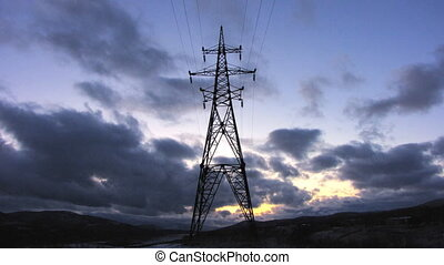 Electricity pylon - Time lapse of running clouds with...