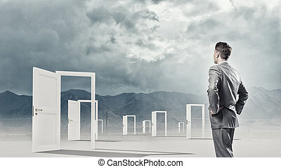 Door to new opportunity - Businessman standing in front of...