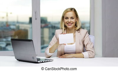 businesswoman showing blank paper card at office - business,...