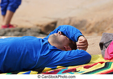 Man relaxing in the sun - Man relaxing and taking a nap...