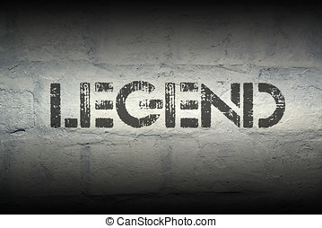legend stencil print on the grunge white brick wall
