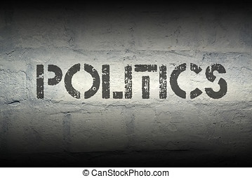 politics stencil print on the grunge white brick wall