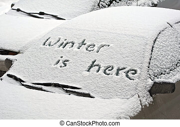 quot;Winter is herequot; - Cars covered by snow during...