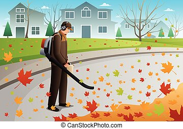 Man Clean Up Leaves During Fall Season Using a Blower - A...