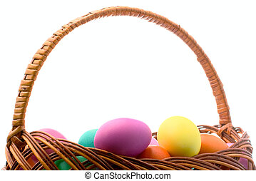 easter eggs in woven basket isolated on white with...