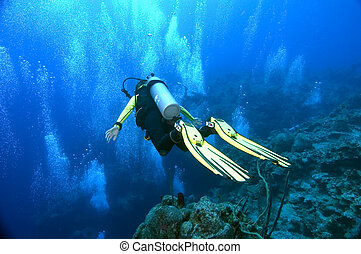 Gliding over 6000ft - Female diver hovering over the edge of...