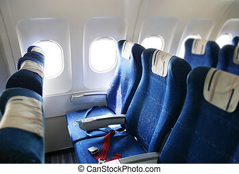 Airplane interior - seat rows in an airplane cabin