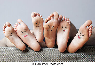 Human soles with painted faces - Human soles with painted...