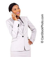 young african business woman talking on cell phone