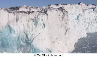 Glacier front - Flying close by and in front of a huge...
