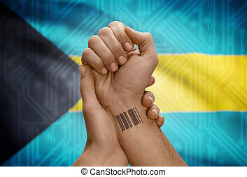 Barcode ID number on wrist of dark skinned person and...
