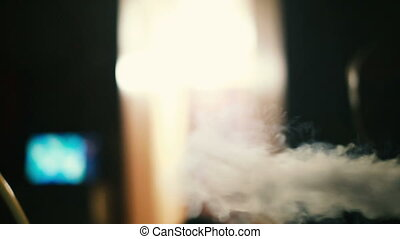 Smoke from a hookah in the dark room. - Smoke from a hookah...