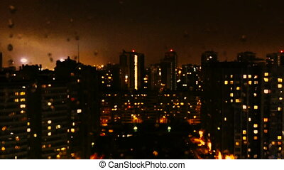 Lights flickering in windows of big city house. - Lights...