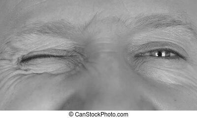 Close-up in black and white on mans eyes, winking eyes HD