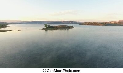 AERIAL VIEW. Small Island In The Middle Of Water Reservoir -...