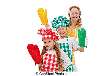 Happy chefs waving to you - kids with large kitchen gloves -...