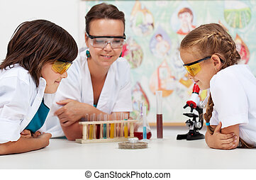Young students watching an experiment in elementary science class