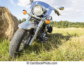 Motorcycle on field countryside. - Motorcycle in a field...