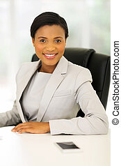 afro american businesswoman relaxing in office