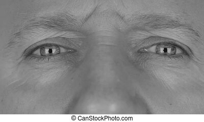 Close-up in black and white on  man's eyes, angry eye