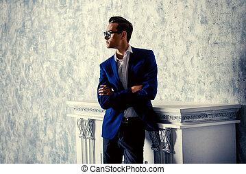shadows - Vogue shot of a handsome elegant man in a suit...