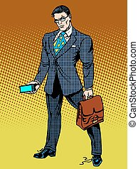Stern businessman with smartphone - Stern businessman with a...
