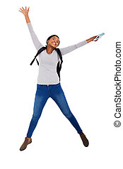 african college student jumping for joy - energetic african...