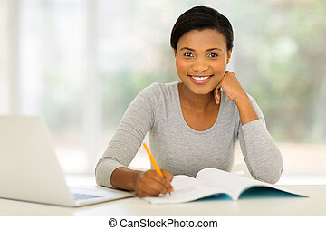 afro american woman studying at home - beautiful afro...