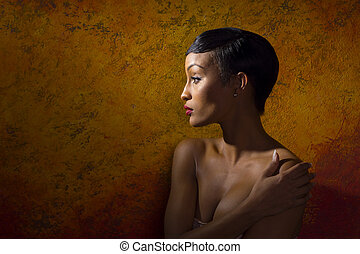 Portrait of nude female model covering her chest