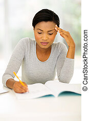 female african college student studying