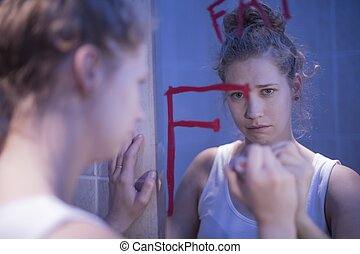 Crying girl in bathroon - Crying girl is looking in the...